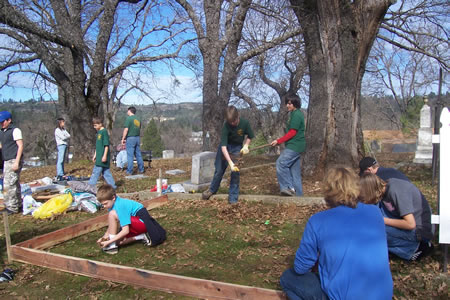 Scouts of Troop 460 help build a memorial flag pole at the Pleasant Valley Cemetery